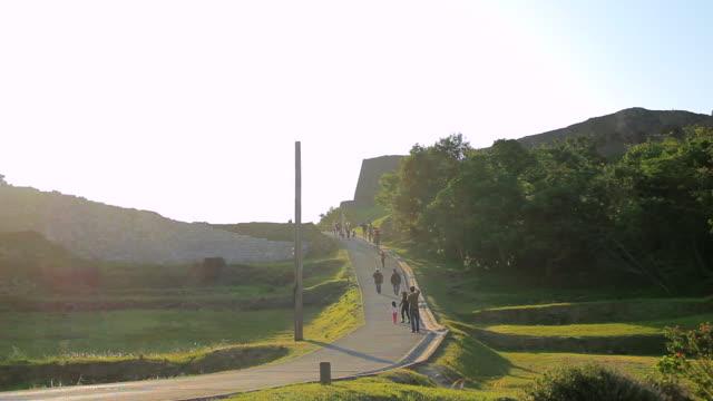 WS View of people walking near Katsuren Castle / Katsuren cho, Okinawa, Japan