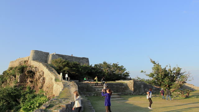 ws view of people walking near katsuren castle / katsuren cho, okinawa, japan - travel destinations点の映像素材/bロール
