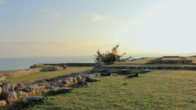 WS PAN View of people walking near Katsuren Castle / Katsuren cho, Okinawa, Japan