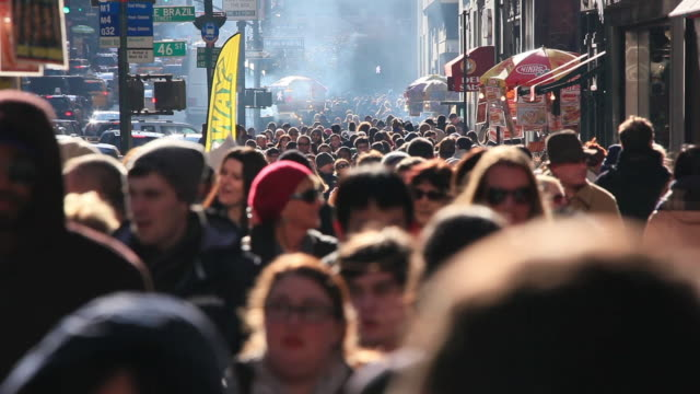 WS View of people walking on crowd sidewalk at fifth avenue in Christmas seasons smoke blowing from street vender which surrounds people with traffic congestion / New York, United States