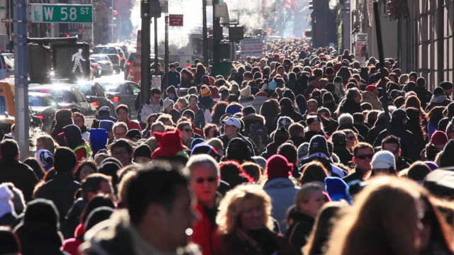 WS View of people walking on crowd sidewalk at fifth avenue in Christmas seasons with traffic congestion / New York, United States
