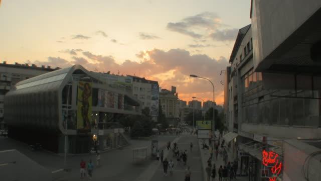 WS ZO View of people walking on Macedonia street at sunset / Skopje, Macedonia