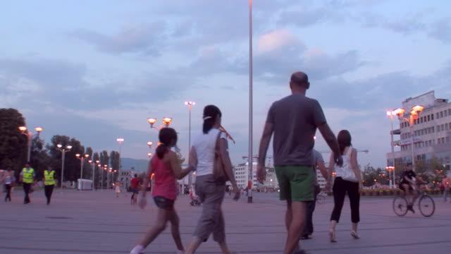 WS ZI View of People walking on Macedonia street at sunset / Skopje, Macedonia