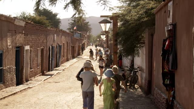 ws view of people walking on street / san pedro de atacama, norte grande, chile - san pedro de atacama stock videos & royalty-free footage