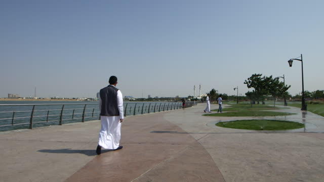 view of people walking on the corniche - red sea stock videos & royalty-free footage