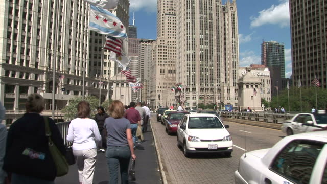 View of people walking through Michigan Avenue Bridge in Chicago United States