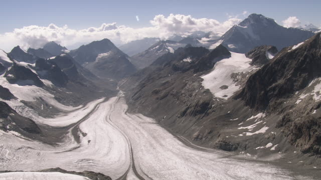 ws aerial view of petit mont collon surrounded by mont collon glacier and otemma glacier / petit mont collon, valais, switzerland - snowcapped mountain stock videos & royalty-free footage