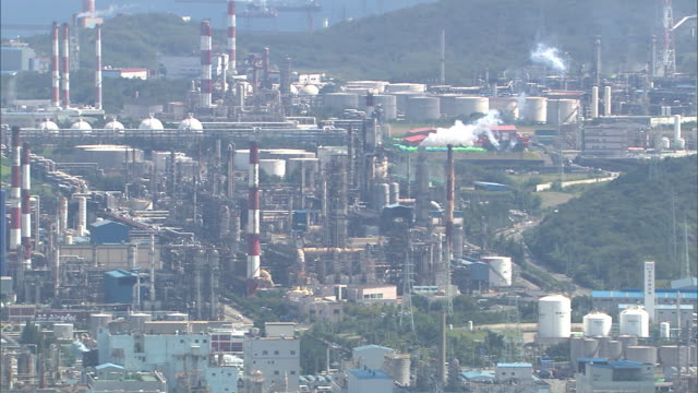 view of petrochemical plant in ulsan at daytime - chemikalie stock-videos und b-roll-filmmaterial