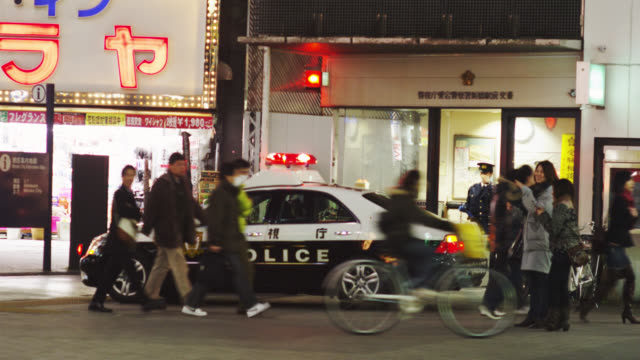 WS View of petrol car parked in front of Shinbashi Police Information Box / Tokyo, Tokyo-To, Japan