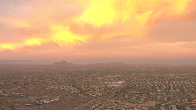 WS AERIAL View of Phoenix Basin with suburbs and mountains surrounding city / Phoenix, Arizona, United States