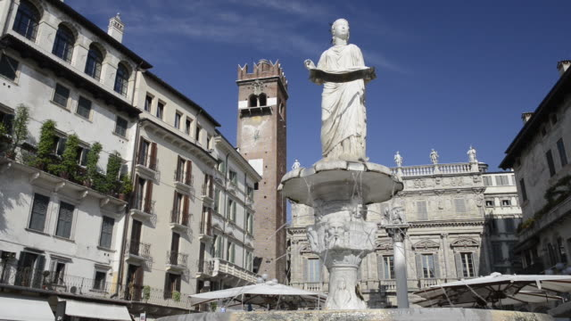 ms view of piazza delle erbe in front of square with fountain madonna verona / verona, veneto, italy - female likeness stock videos & royalty-free footage
