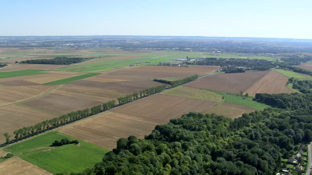ws aerial zi pan view of picardy fieldscape with airport / picardy, france - hay field stock videos & royalty-free footage