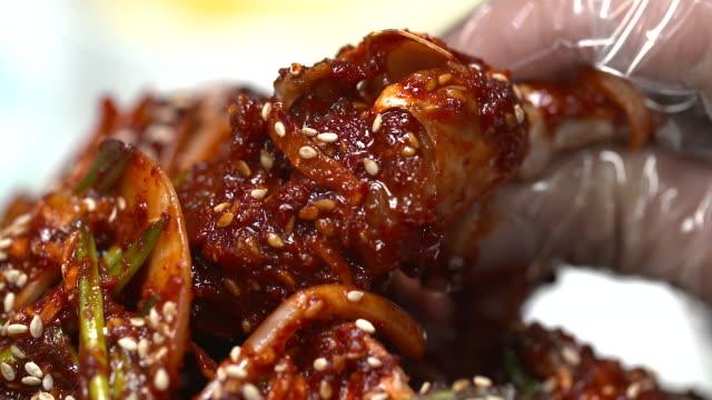 view of picking up yangnyeom gejang(seasoned marinated raw crab) - marinated stock videos and b-roll footage