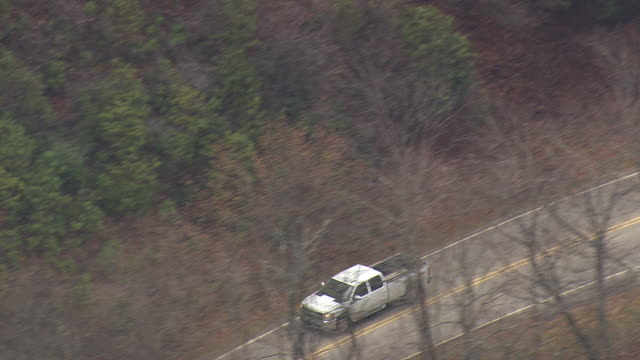 MS AERIAL TS View of Pickup Car moving on Blue Ridge Parkway/ North Carolina, United States