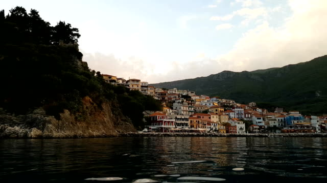 view of picturesque greek seaside village at dusk - fishing village stock videos and b-roll footage