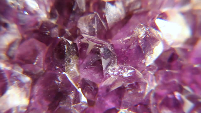 vídeos de stock e filmes b-roll de ecu slo mo view of piece of purple crystal / miami, florida, united states - purple