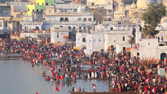 ws view of pilgrims bathing in sacred holy lake at ajmer / pushkar, rajasthan, india  - rajasthan stock videos and b-roll footage