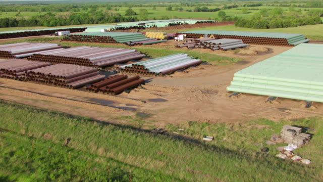WS AERIAL View of Pipes at TransCanda pipeline yard in Payne county / Oklahoma, United States