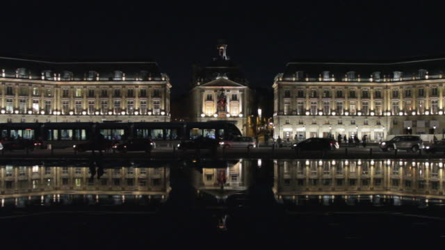 WS View of Place de la Bourse with traffic in foreground at night / Bordeaux, Aquitaine, France.
