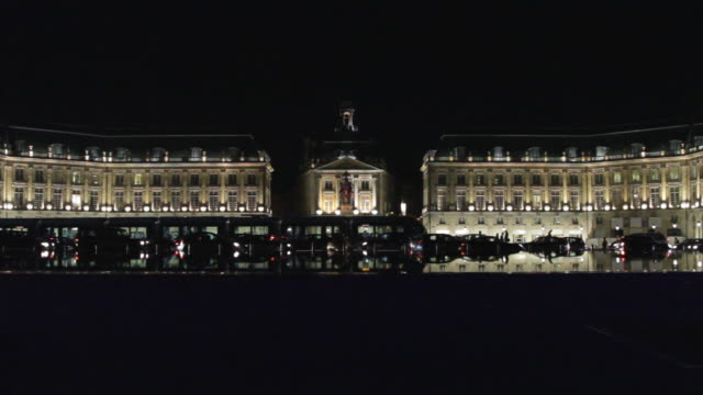 WS View of Place de la Bourse with tram and traffic in foreground at night / Bordeaux, Aquitaine, France.