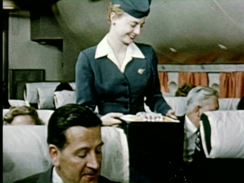 vídeos de stock e filmes b-roll de ms view of plane and airline passengers  audio / germany - 1956