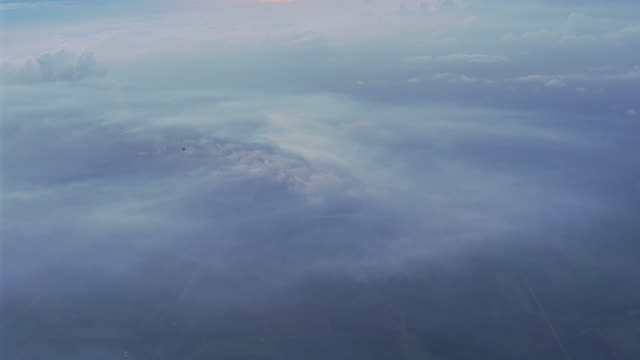 WS AERIAL View of plane flying over smoke and burn / Ayr, Queensland, Australia
