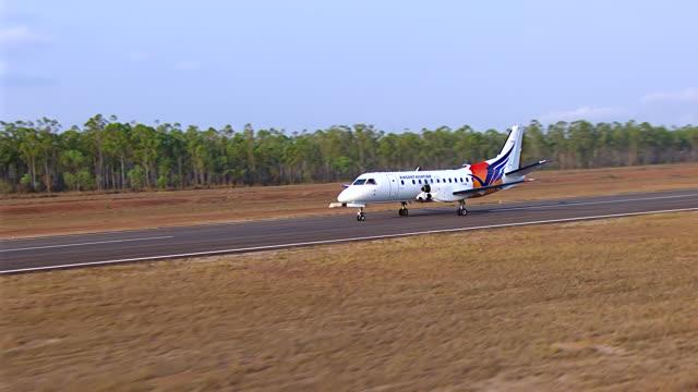 WS AERIAL View of plane on runway / Darwin, Northern Territory, Australia