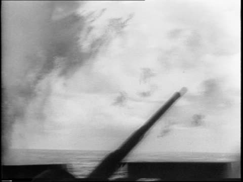 view of planes in sky battleships artillery fire from deck of battleship - battle stock videos & royalty-free footage