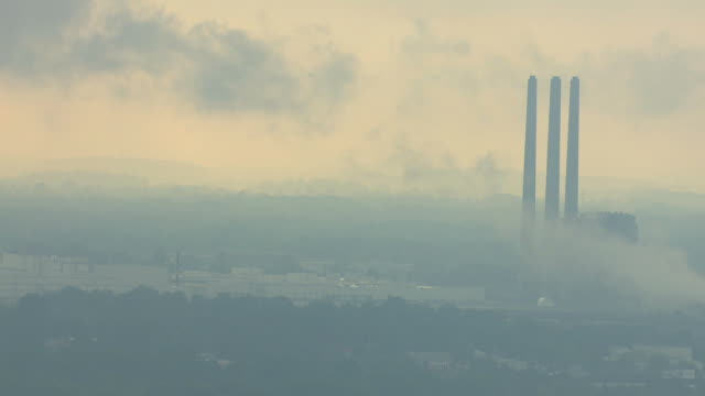 ws aerial view of plant towers in morning fog at lansing car assembly plant / lansing, michigan, united states - lansing stock videos & royalty-free footage