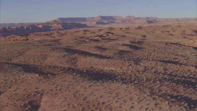 ws pov aerial view of plateaus and canyons in desert at sunset / ute, nevada, usa - nevada stock-videos und b-roll-filmmaterial