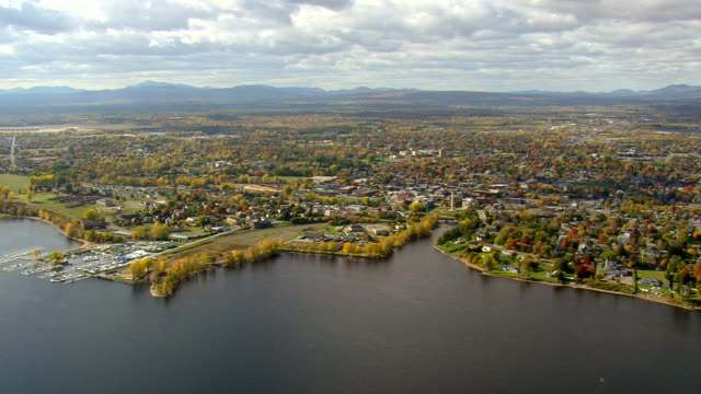 ws aerial zi view of plattsburgh city at near bay / new york, united states - plattsburgh stock videos and b-roll footage