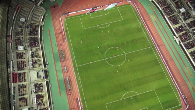ws zo aerial view of playing a soccer game in hwaseong sports complex at night / hwaseong, gyeonggi-do, south korea - stadium stock videos and b-roll footage