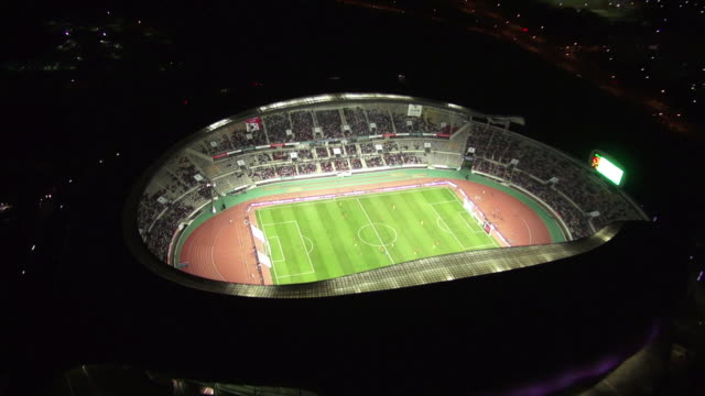 WS AERIAL View of playing a soccer game in hwaseong sports complex at night / hwaseong, gyeonggi-do, South Korea