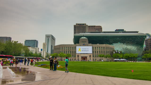 view of plaza and fountain in front of seoul city hall - orthographic symbol stock videos and b-roll footage