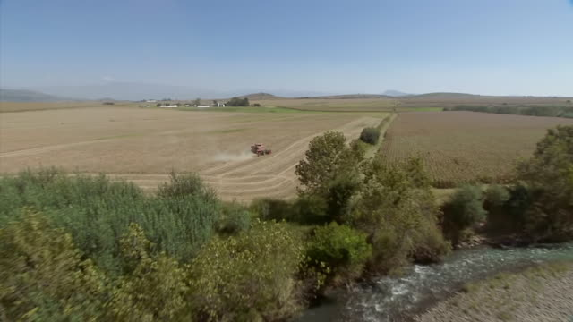 WS AERIAL View of plough on farm plot / Kwazulu Natal, South Africa