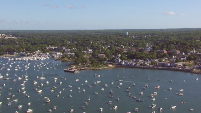 ws aerial pov view of plymouth harbour with town and tree area in background / plymouth, massachusetts, united states - massachusetts stock-videos und b-roll-filmmaterial