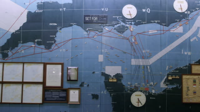 ws view of plywood map plotting the normandy invasion hangs on wall at southwick house / portsmouth, united kingdom - d day stock-videos und b-roll-filmmaterial