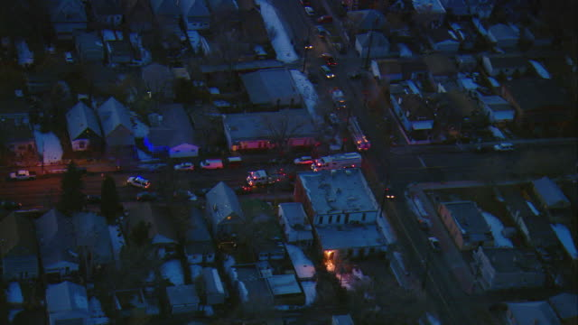 WS ZI POV AERIAL View of police and fire vehicles surrounding incident in urban residential area of south Denver / Denver, Colorado, USA