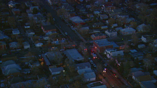 WS POV AERIAL View of police and fire vehicles surrounding the scene of incident in urban residential area of south Denver / Denver, Colorado, USA