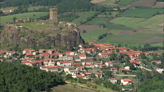 AERIAL, View of Polignac with ruins of castle, Auvergne, France