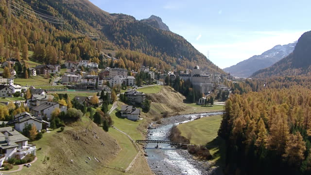 ws aerial view of pontresina with flaz river and hotel walther / pontresina, upper engadin, switzerland - dorf stock-videos und b-roll-filmmaterial