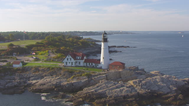 ws aerial pov view of portland head light with sea/ portland, maine, united states - maine stock videos & royalty-free footage
