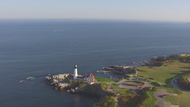 WS AERIAL POV View of Portland Head Light with sea/ Portland, Maine, United States