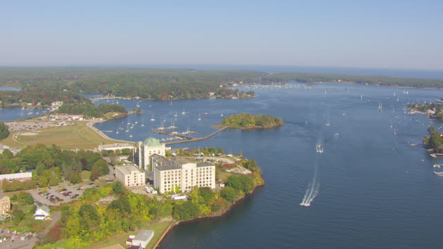 ws aerial pov view of portsmouth naval prison, boats moving in foreground / kittery, maine, united states - kittery stock videos & royalty-free footage