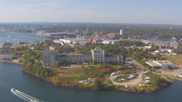 ws aerial pov view of portsmouth naval prison, portsmouth naval shipyard in background / kittery, maine, united states - kittery stock videos & royalty-free footage