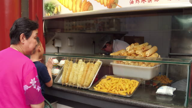 a view of potato chips in famous wangfujing snack street on may 4 2017 in beijing china wangfujing is a main business street for tourism next to the... - salty snack stock videos & royalty-free footage