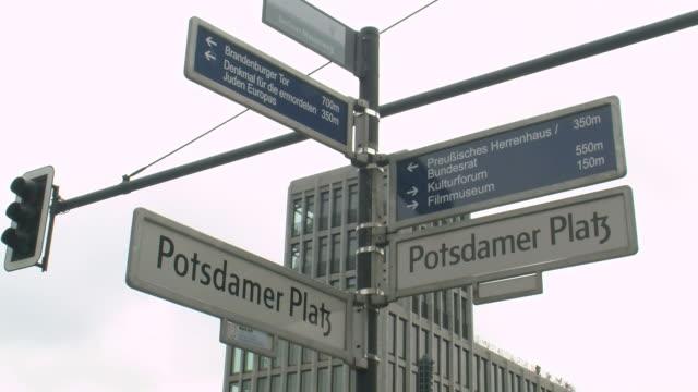 stockvideo's en b-roll-footage met cu view of potsdamer platz traffic signs  / berlin, germany - straatnaambord