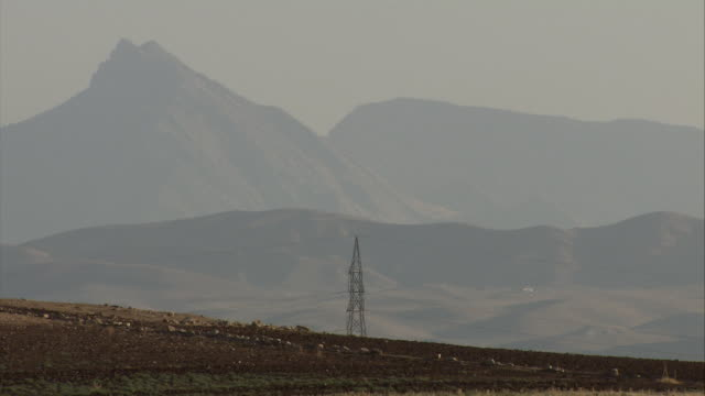 WS View of Powerlines in front of hills / Sulaymaniyah, Kurdistan, Iraq