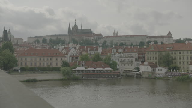 view of prague castle from charles bridge - hradcany square stock videos and b-roll footage