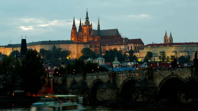 view of prague castle over charles bridge - hradcany castle stock videos and b-roll footage